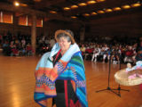Elaine receiving a blanket as a gift, Suquamish, WA, 2009