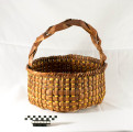 Large cedar basket with a intertwined cedar handle